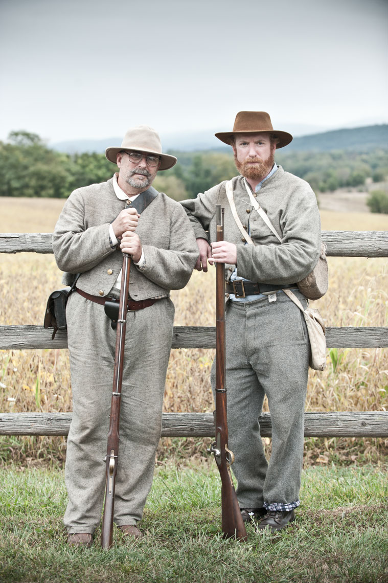 Civil War reenactors at Antietam: Father and son reenactors James and Jason Tinney pose for the camera