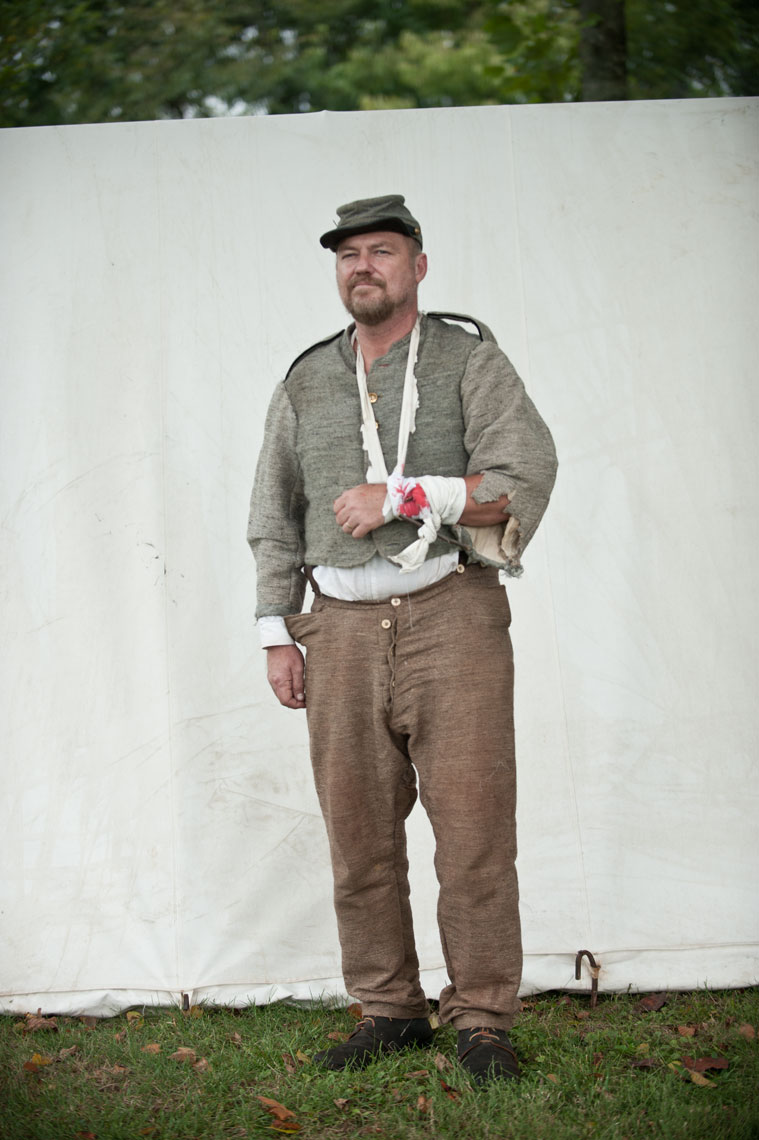 Civil War reenactors at Antietam: a reenactor with dressed wounds