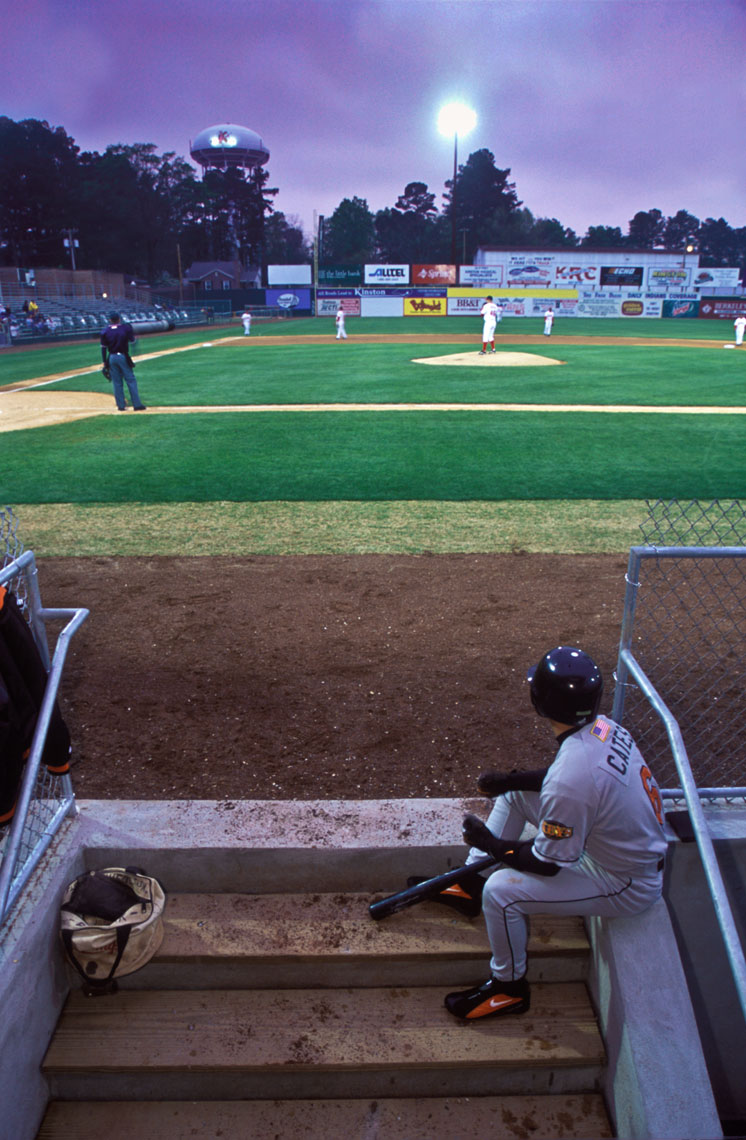 Gary Cates watches from the dugout during a Frederick Keys v. Kinston Indians game