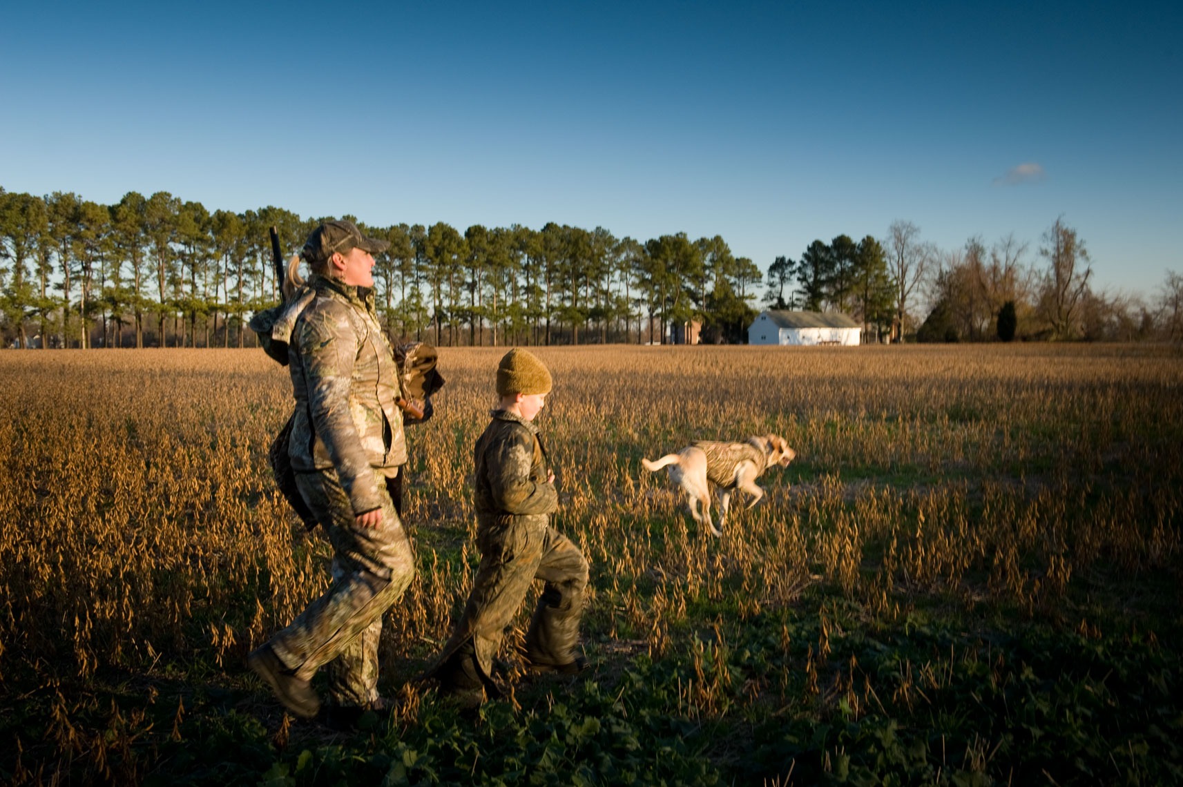 Hunting for waterfowl on the Eastern Shore of Maryland: a mother and son headed out to hunt at sunrise