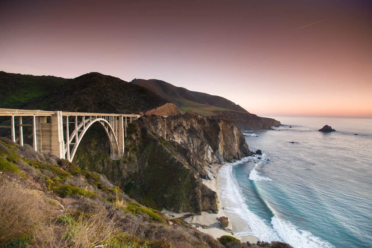 Historic Bixby Bridge crossing Bixby Creek over the Pacific Ocean at sunset, in Big Sur, California