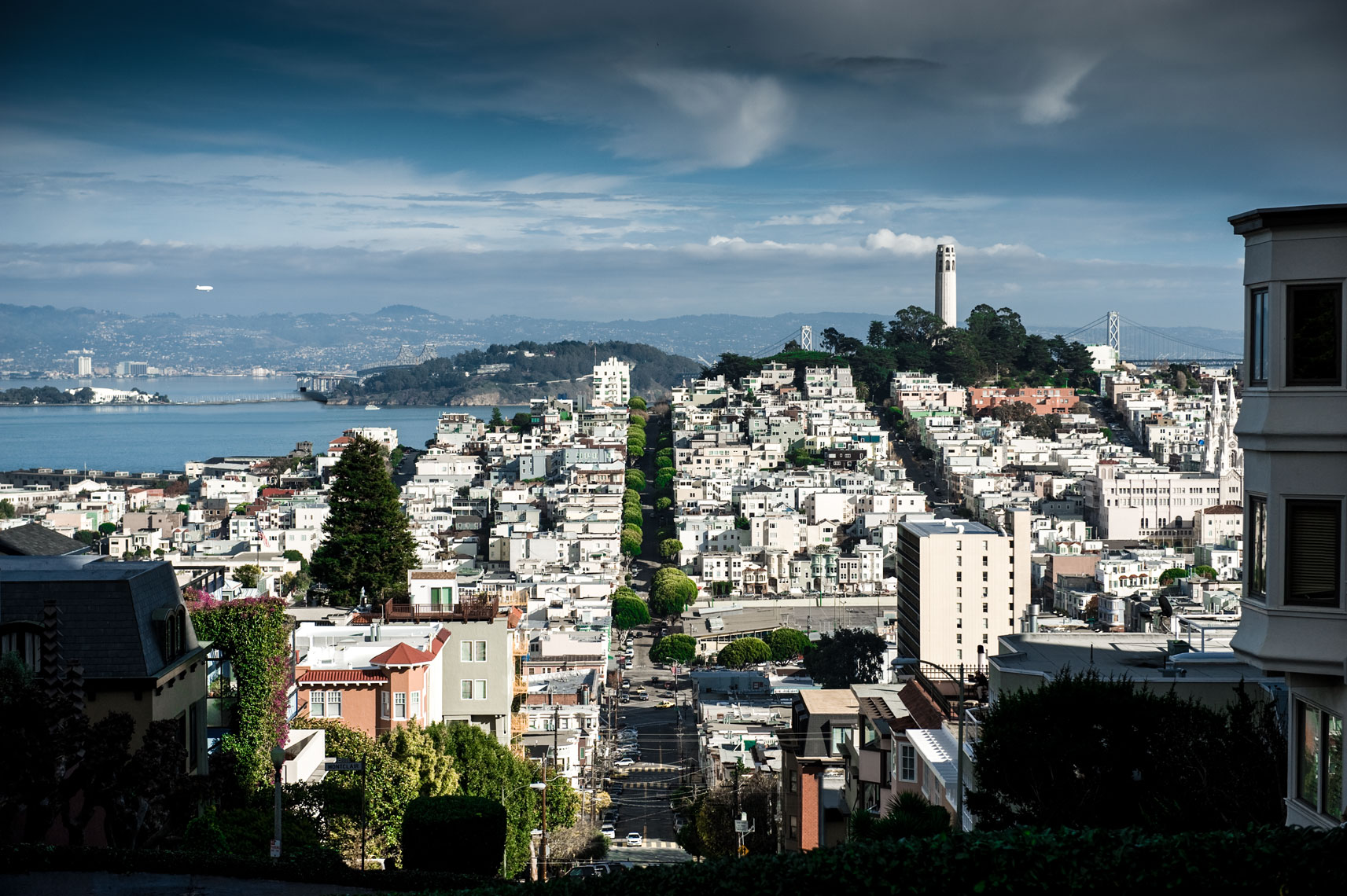 View of Coit Tower from atop Lombard Street in San Francisco, California