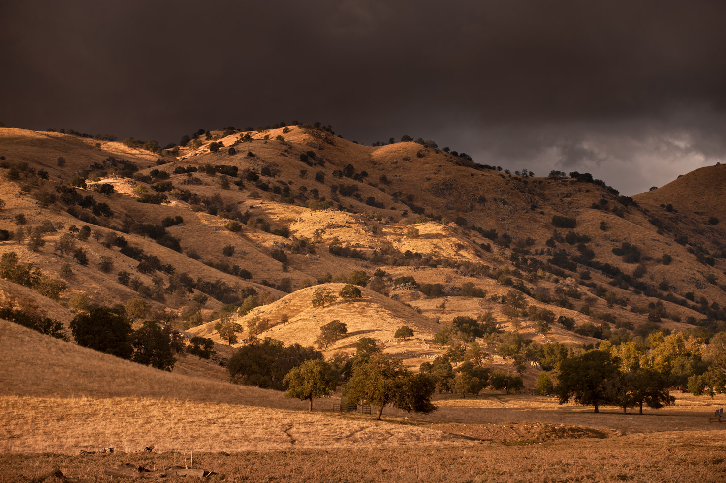 Sunset grazes the hills of the Yokohl Valley as a storm sweeps in off the mountains