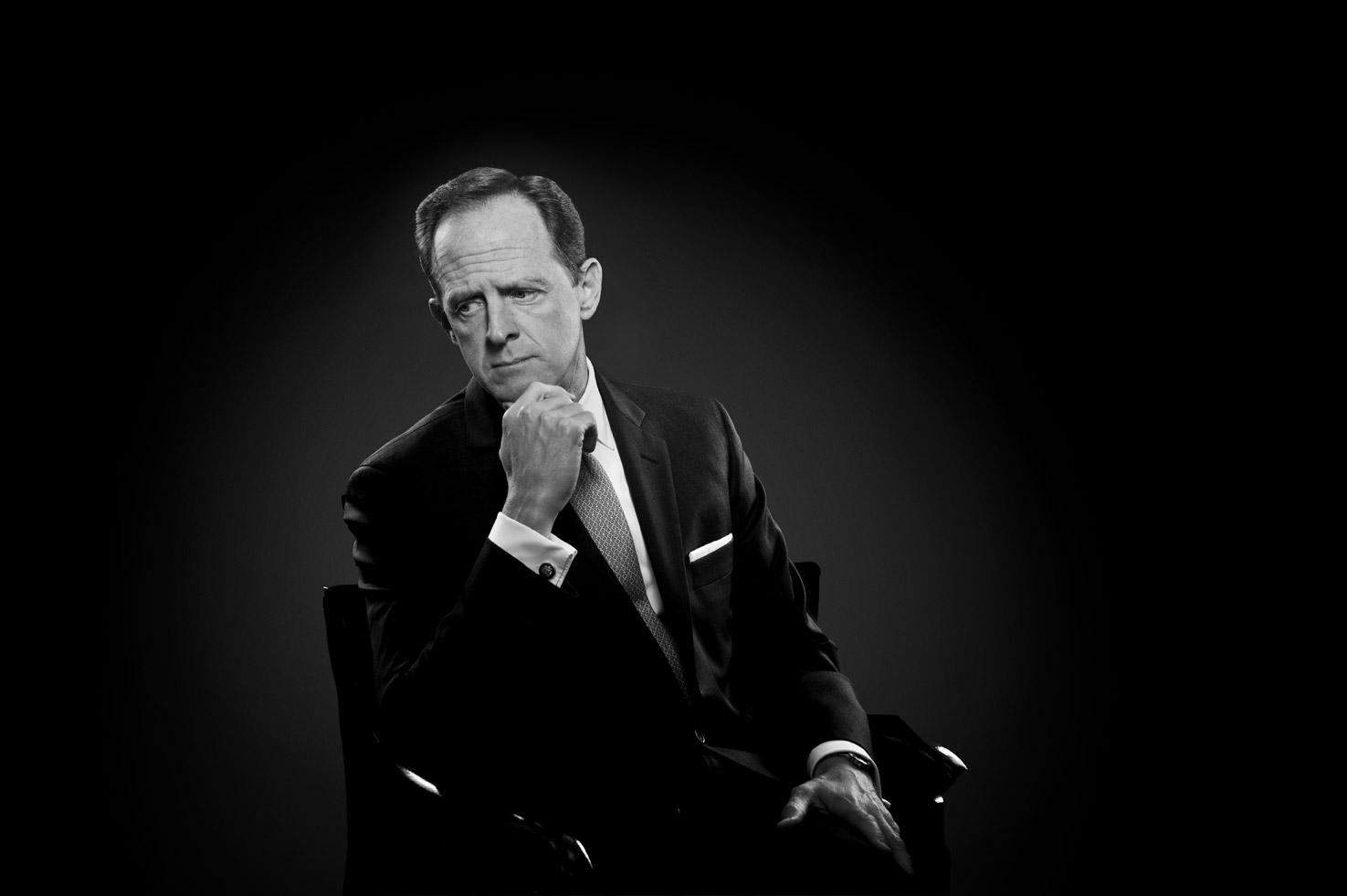 Black and white portrait of US Senator Pat Toomey seated and resting his chin on his hand