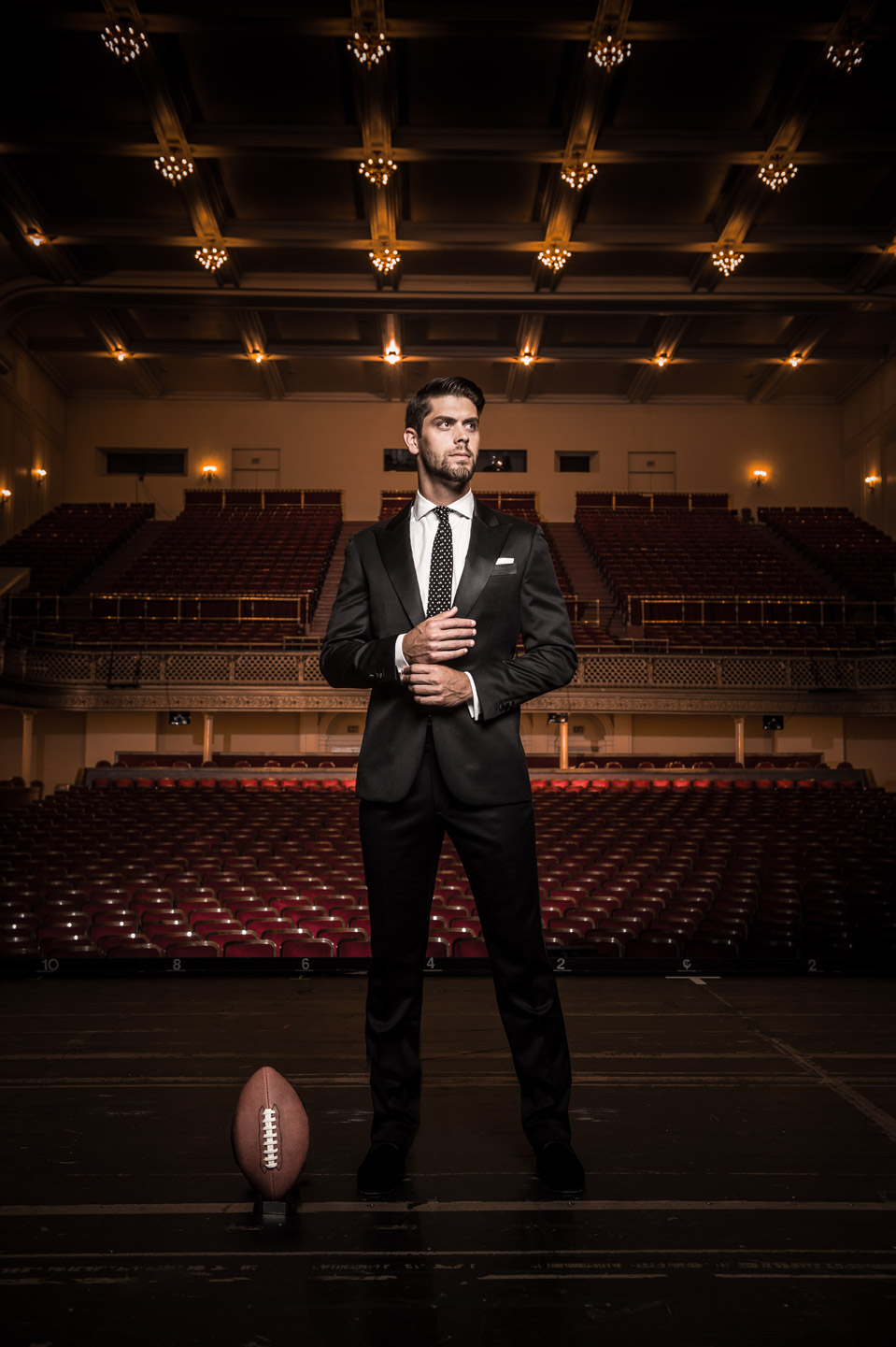 Baltimore Ravens kicker Justin Tucker standing on stage at the Lyric Opera House