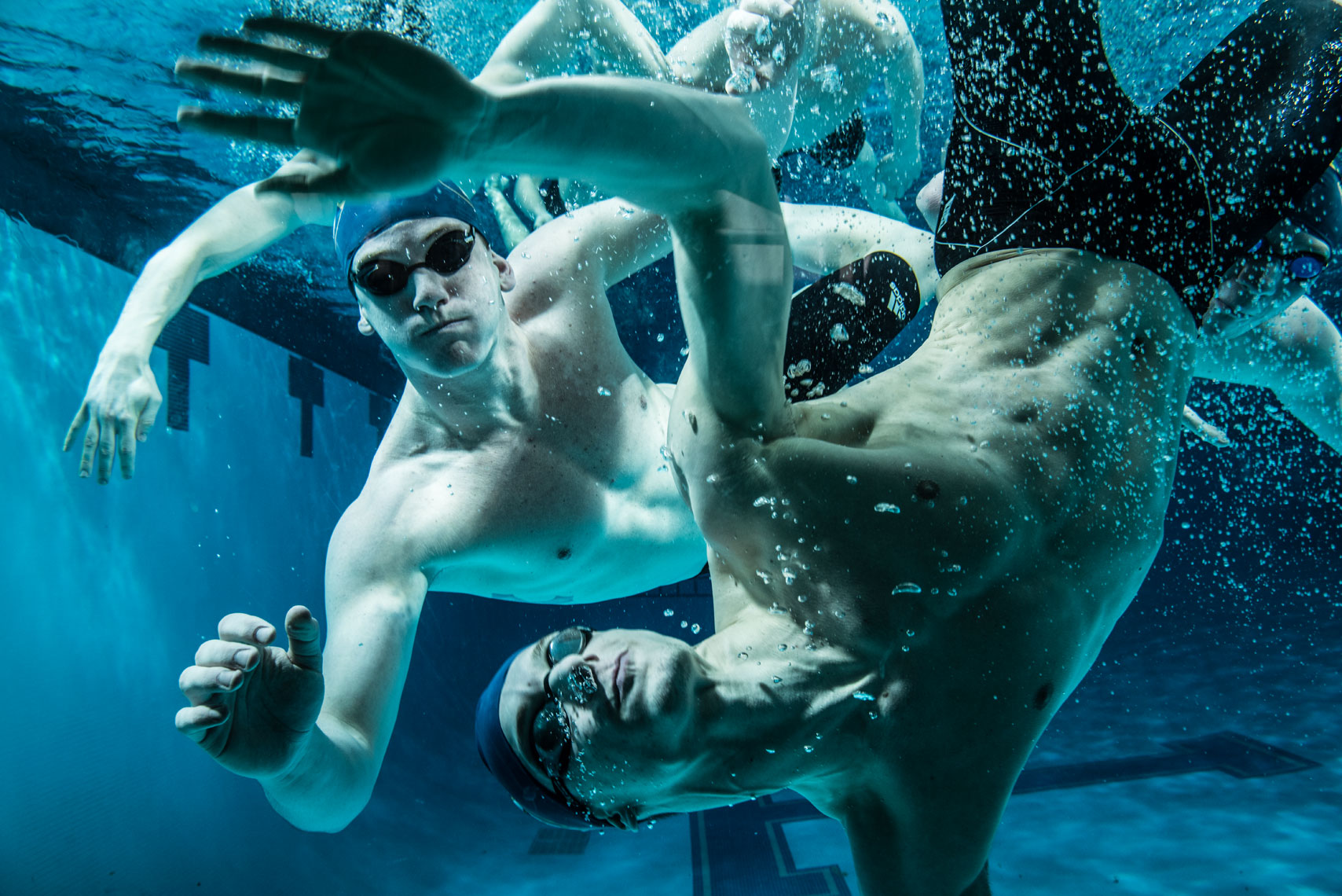 College swimmers underwater in the pool