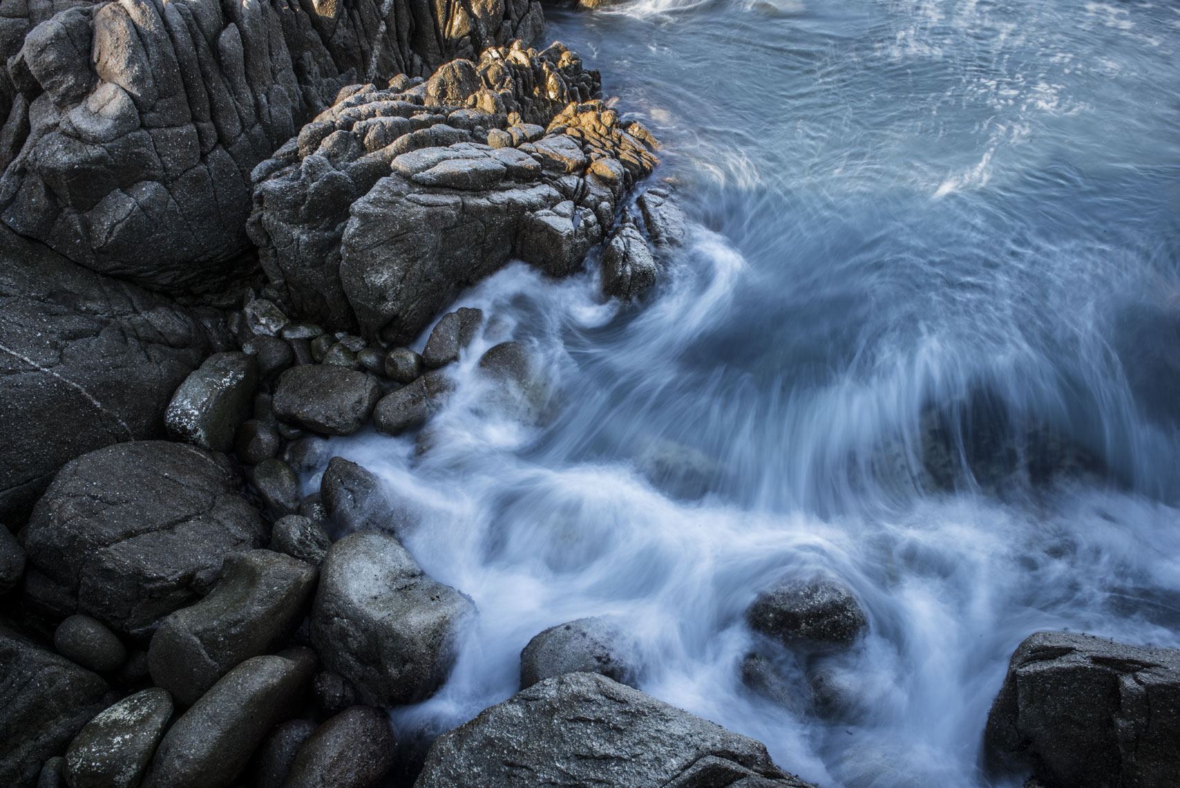 Water swirls in the rocks at Lover