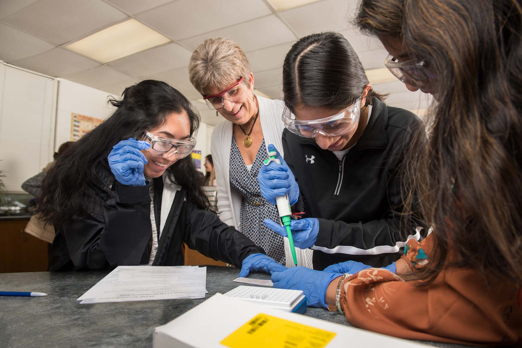 Easton High School ROP students work on a chemistry project as their teacher watches