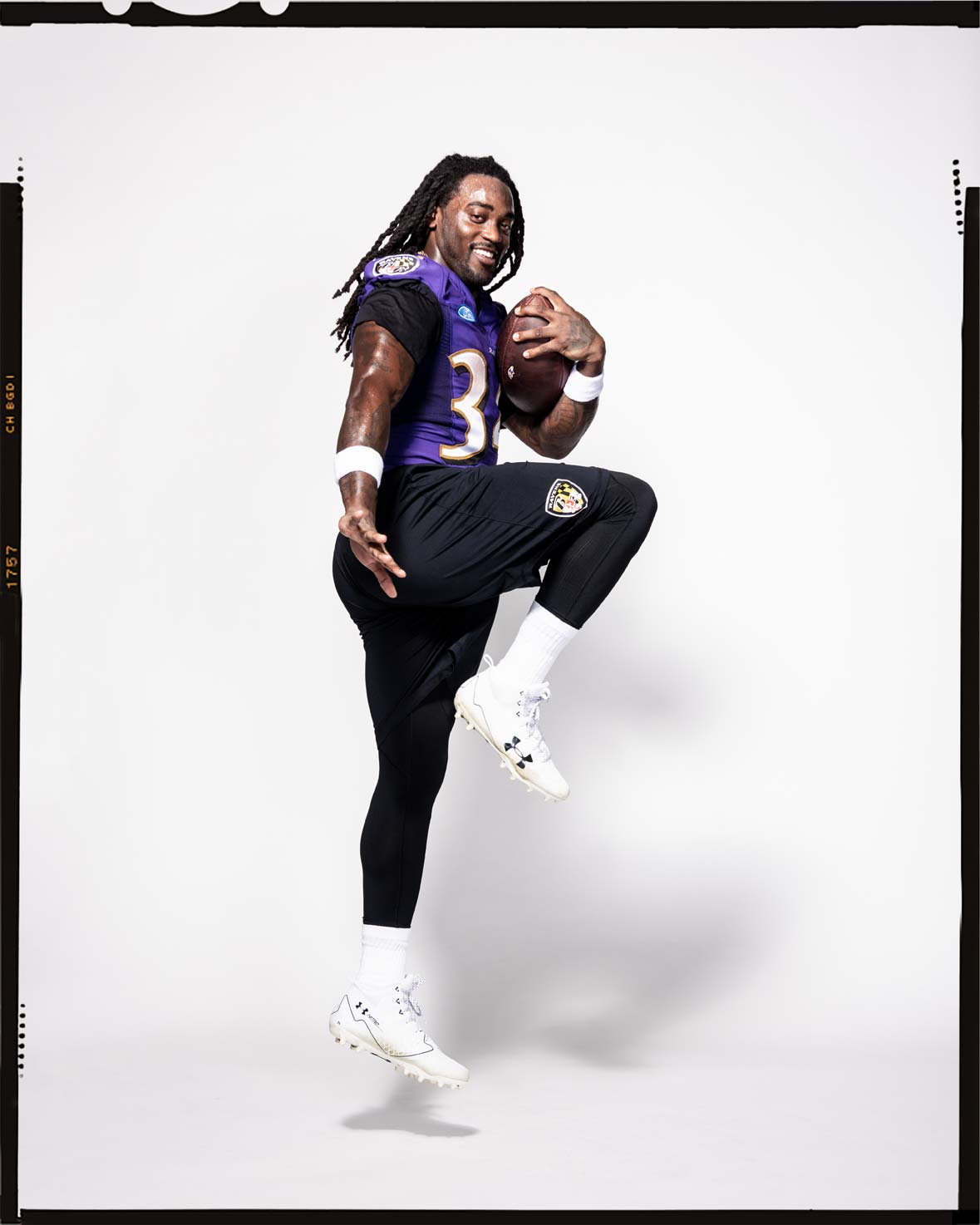 Baltimore Ravens running back Alex Collins striking a Heisman pose in uniform