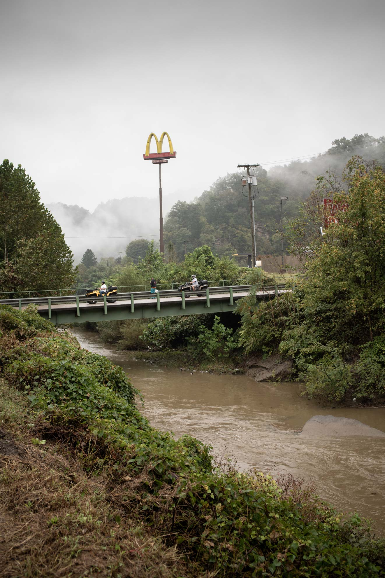National Trailfest: ATV riders cross the river next to the McDonalds