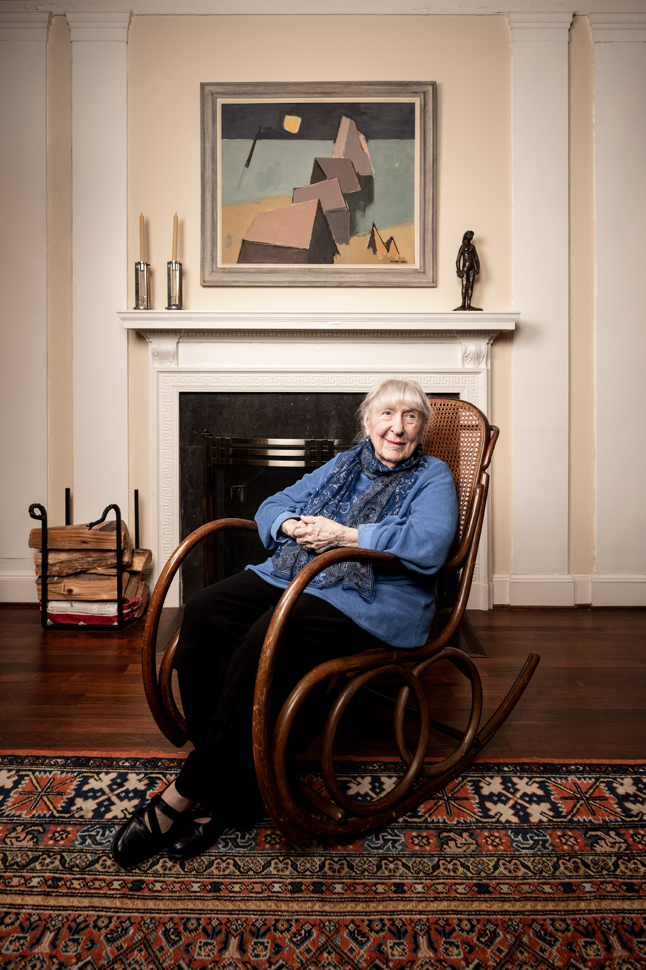 Lois Feinblatt seated in a rocking chair in her Baltimore home