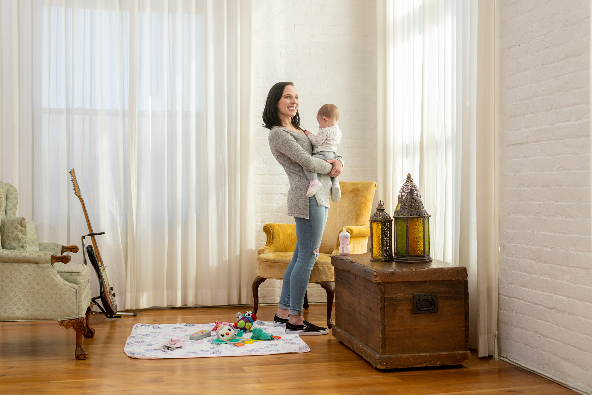 Mother and infant daughter standing in a living room for the Indivior annual report