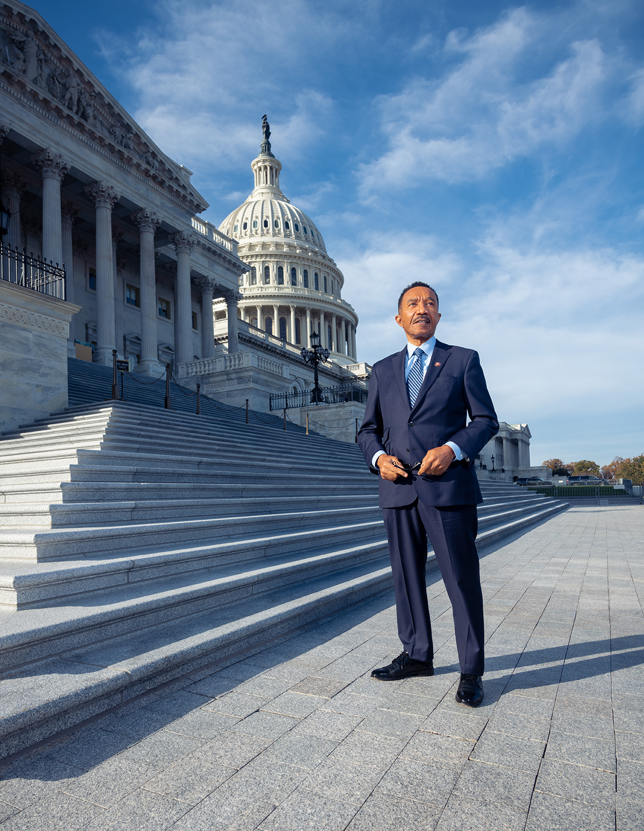 Congressman Kweisi Mfume standing on the steps of the US Capitol